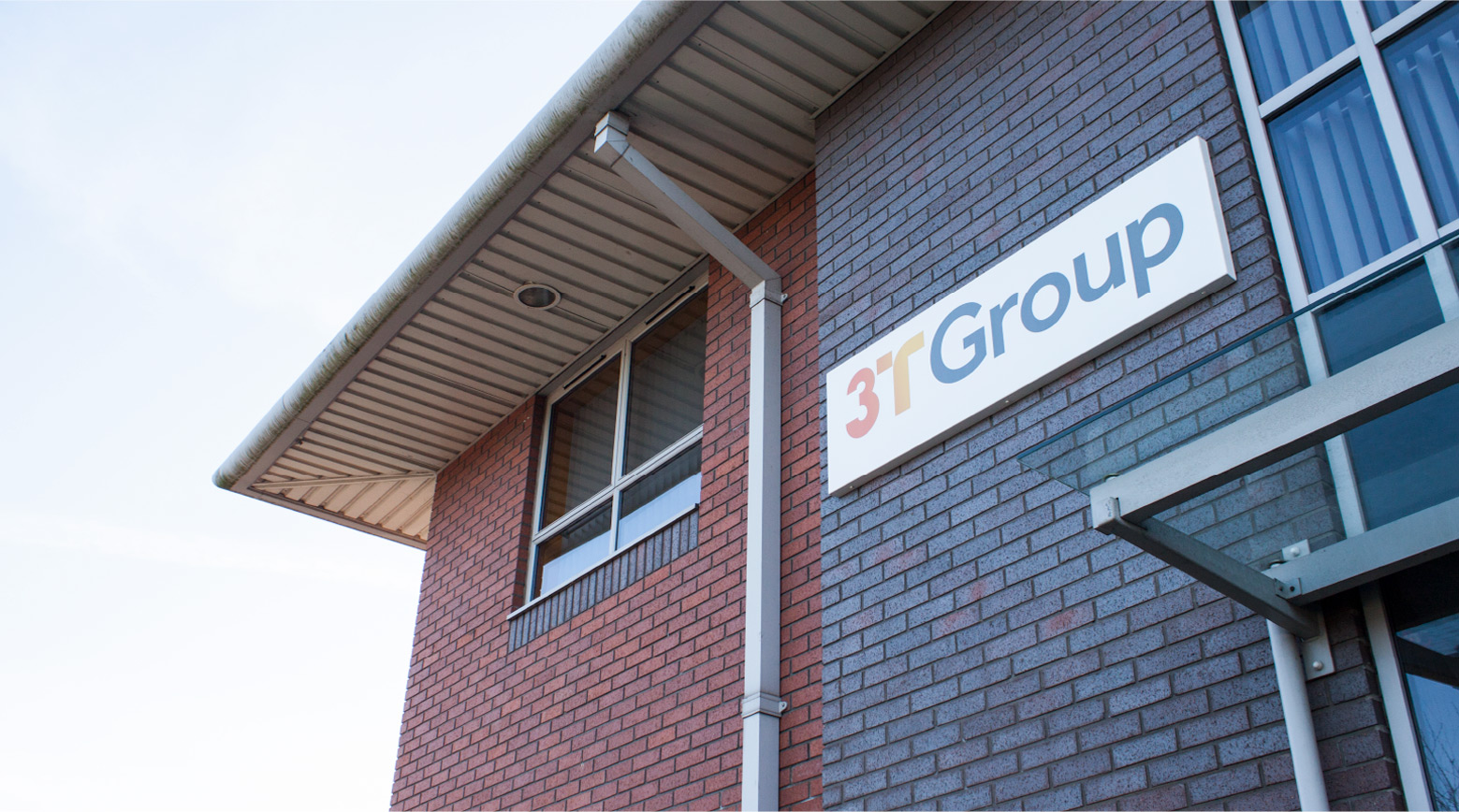 3T Group Logo on side of building