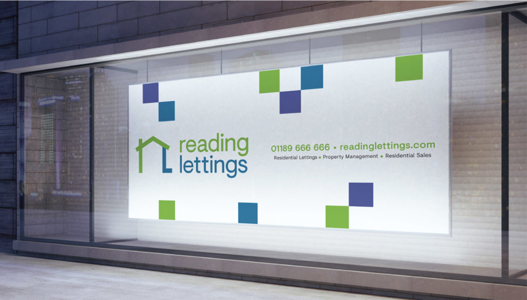 Reading Letting poster on side of glass wall