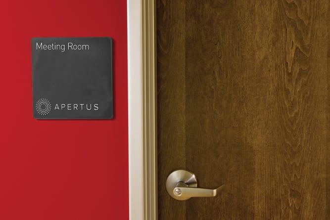 Apertus label on door