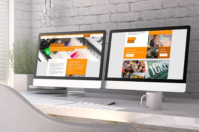 Visions Group website on 2 computer screens